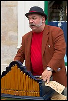 Street musician with Barrel organ. Quartier Latin, Paris, France