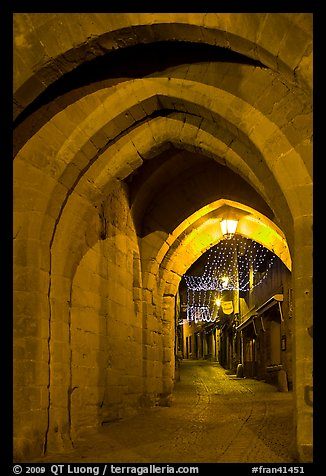 Rue Cros Mayerevielle through medieval Porte Narbornaise. Carcassonne, France