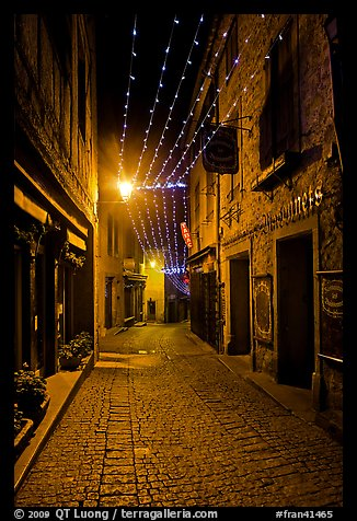 Medieval street by night with Christmas decorations and. Carcassonne, France (color)