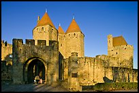 Main entrance of medieval city  with child and adult walking in. Carcassonne, France (color)