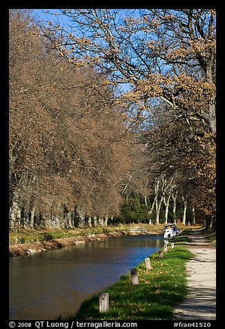 Walkway and boat along Canal du Midi. Carcassonne, France (color)