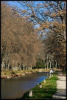 Walkway and boat along Canal du Midi. Carcassonne, France