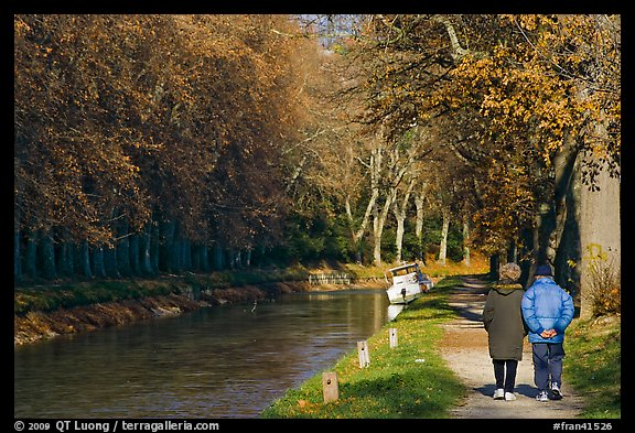 Couple walking along Canal du Midi. Carcassonne, France (color)