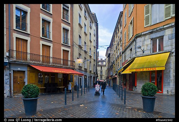 Pedestrian street with couple pushing stroller. Grenoble, France (color)