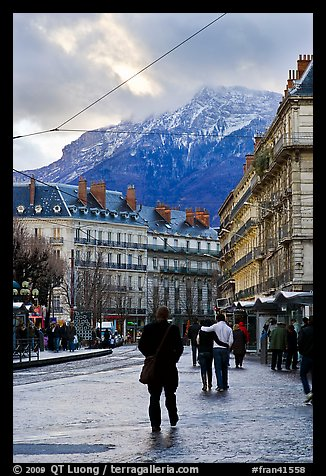 Downtown street and snowy mountains of the Belledone Range. Grenoble, France (color)