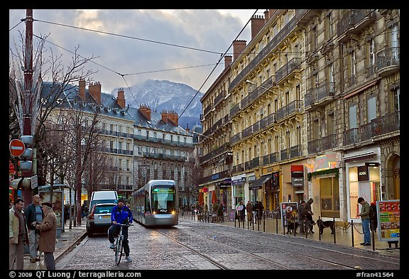 Bicyclist and tramway next to Victor Hugo place. Grenoble, France (color)