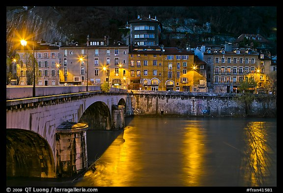 Isere River, Citadelle stone bridge and old houses at dusk. Grenoble, France (color)