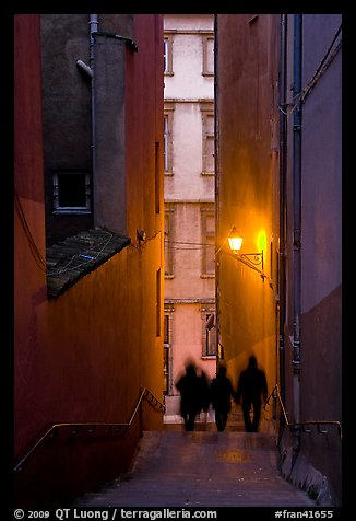 Silhouettes in staircase on Fourviere Hill at dusk. Lyon, France (color)