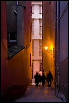 Silhouettes in staircase on Fourviere Hill at dusk. Lyon, France ( color)