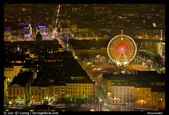Bellecour square with Ferris wheel at night, seen from above. Lyon, France (color)
