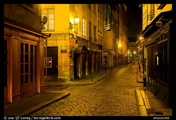 Narrow cobblestone street in historic district at night. Lyon, France (color)