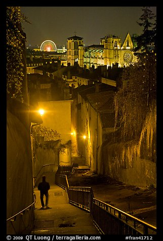Man walking down stairs from Fourviere Hill, with St-Jean Cathedral below. Lyon, France (color)