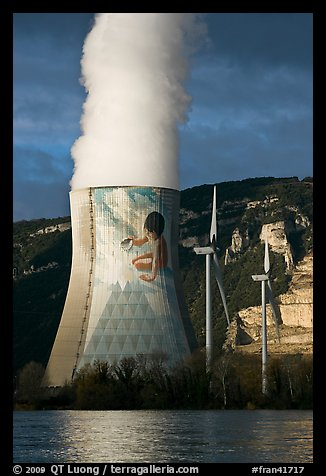 Cooling tower of nuclear power plant with ecology-themed art by Jean-Marie Pierret, and windmill. Provence, France (color)