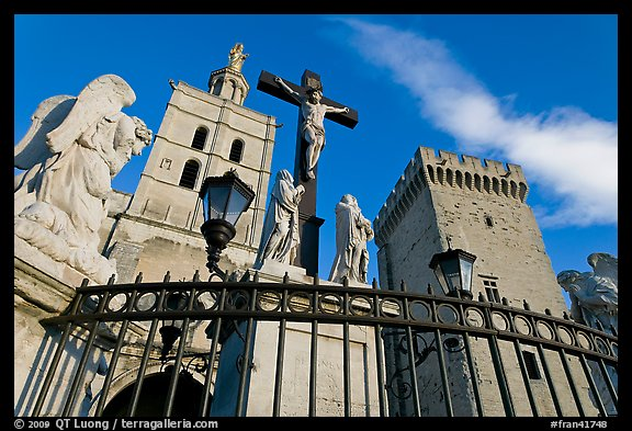 Crucifix in front of Notre-Dame-des-Doms Cathedral. Avignon, Provence, France