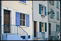 Facade of townhouses with colorful shutters. Arles, Provence, France ( color)