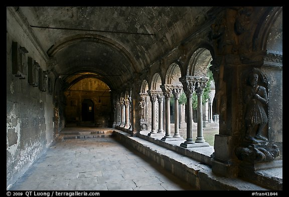 Romanesque gallery with delicately sculptured columns, St Trophimus cloister. Arles, Provence, France (color)