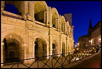 Arenes and church at night. Arles, Provence, France