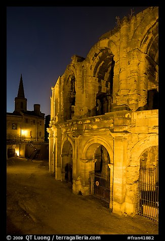Roman arenes and church at night. Arles, Provence, France (color)