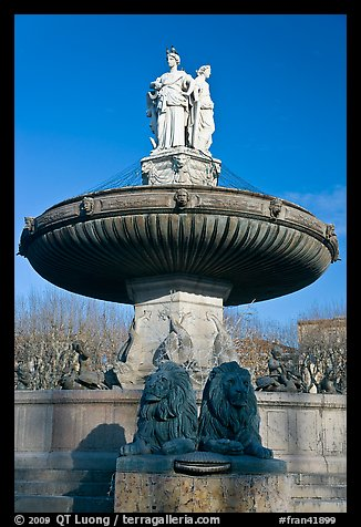 Monumental fountain with three statues representing art, justice and agriculture. Aix-en-Provence, France (color)