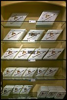 Calisson d'Aix boxes on shelves. Aix-en-Provence, France (color)