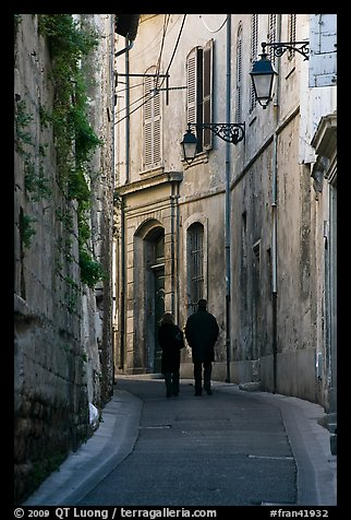 Couple walking in old street. Arles, Provence, France (color)