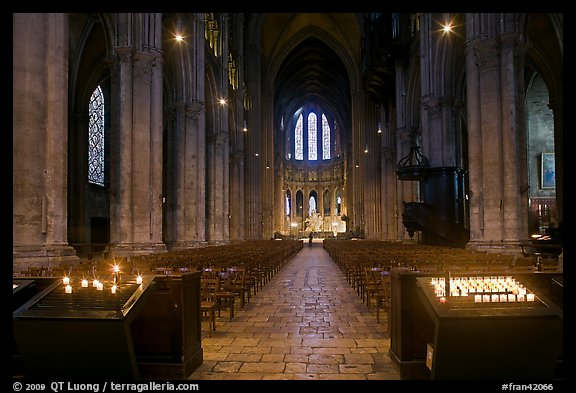 Candles and nave inside Cathedrale Notre-Dame de Chartres. France