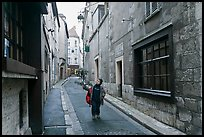 Boy walking in narrow street, Chartres. France ( color)