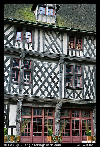 Facade of medieval half-timbered house, Chartres. France (color)