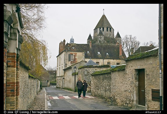 Street with couple walking and Caesar's Tower in background, Provins. France (color)