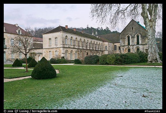 Lawn and forge in winter, Abbaye de Fontenay. Burgundy, France (color)