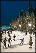 Holiday ice ring, City Hall by night. Paris, France