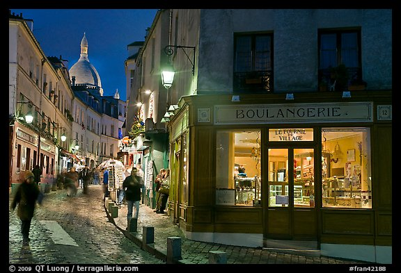 Bakery, street and dome of Sacre-Coeur at twilight, Montmartre. Paris, France (color)