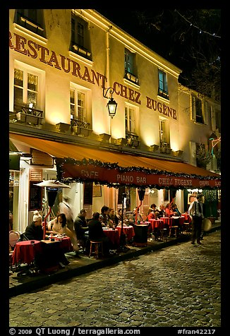 Restaurant with outdoor sitting by night, Montmartre. Paris, France (color)