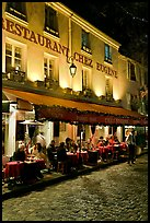 Restaurant with outdoor sitting by night, Montmartre. Paris, France