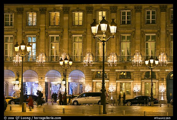 Lights and palace-like classical fronts of Hotel Ritz by Jules Hardouin-Mansart. Paris, France (color)