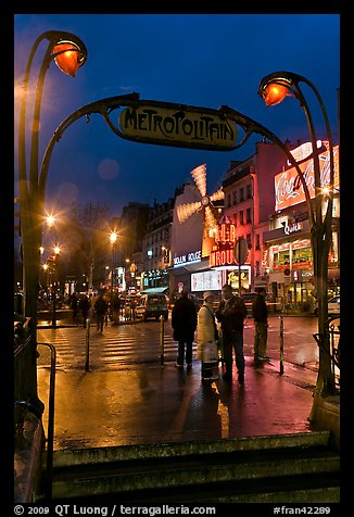 Art deco subway entrance and Moulin Rouge by night. Paris, France (color)