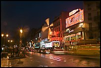 Boulevard by night with Moulin Rouge. Paris, France (color)