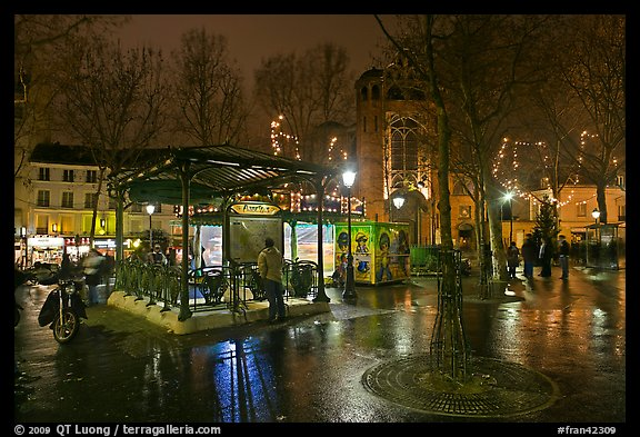 Public square on rainy night. Paris, France (color)