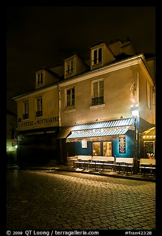 Houses with restaurant at street level, Montmartre. Paris, France (color)