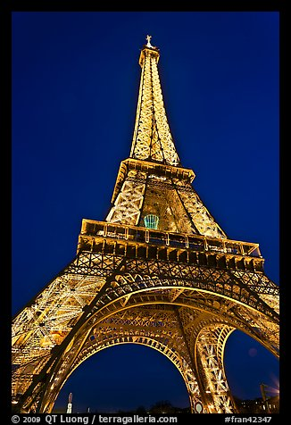 Illuminated  Eiffel Tower seen from close. Paris, France (color)