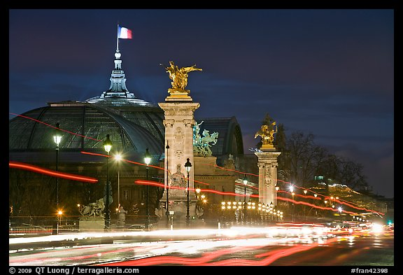Petit Palais and trafic across Alexandre III bridge by night. Paris, France (color)