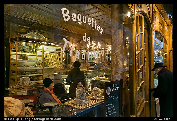 Elderly man entering bakery with people inside. Paris, France (color)