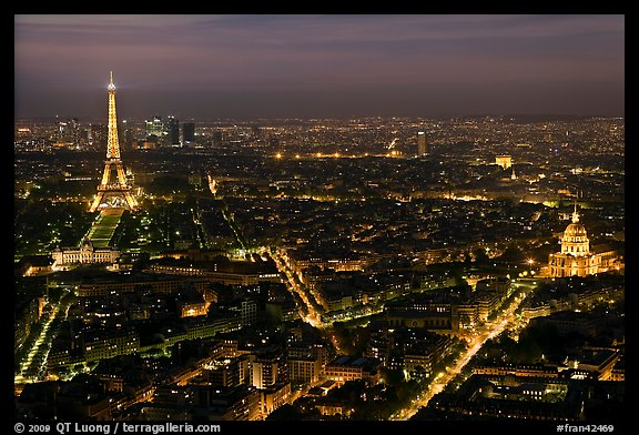 Aerial view at night with Eiffel Tower, Invalides, and Arc de Triomphe. Paris, France (color)