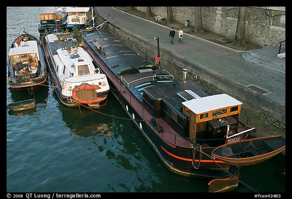 Barges and quay, Seine River. Paris, France