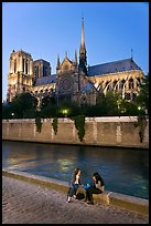Two women having picnic across Notre Dame cathedral. Paris, France ( color)