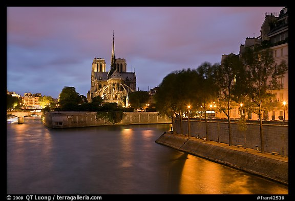 Banks of the Seine River, Ile de la Cite, Ile Saint Louis, and Notre Dame at twilight. Paris, France (color)