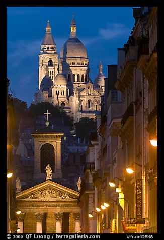 Church of Notre-Dame-de-Lorette with the Basilica of the Sacre Coeur behind at night. Paris, France (color)