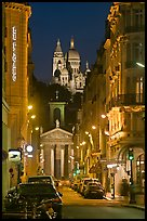 Street, Notre-Dame-de-Lorette, and Sacre Coeur at night. Paris, France (color)