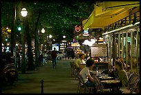 Outdoor cafe terrace on the Grands Boulevards at night. Paris, France (color)