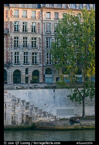 Quay and riverfront buildings on banks of the Seine. Paris, France (color)